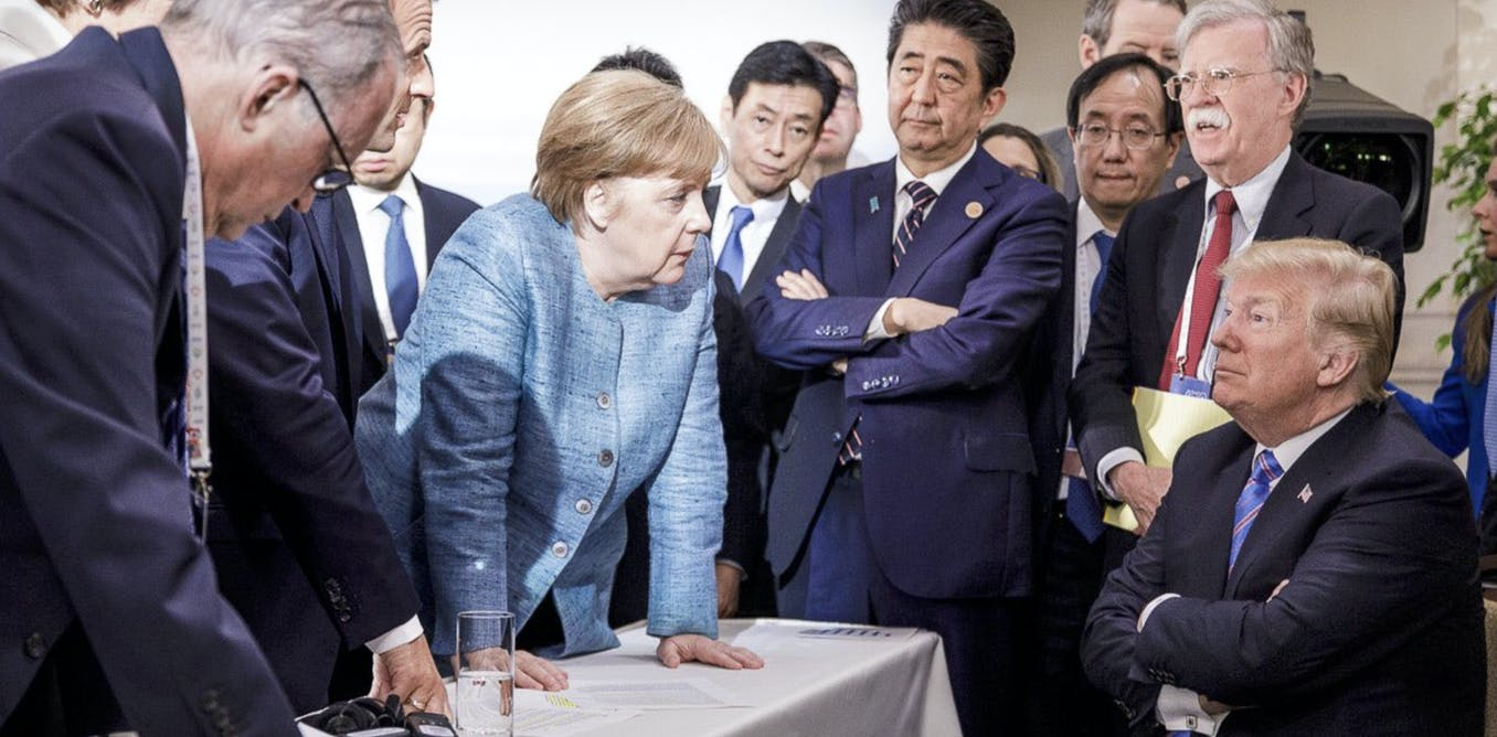 German Chancellor Angela Merkel, center, speaks with U.S. President Donald Trump, at the contentious G7 Leaders Summit in Canada in June. AP/Jesco Denzel/German Federal Government